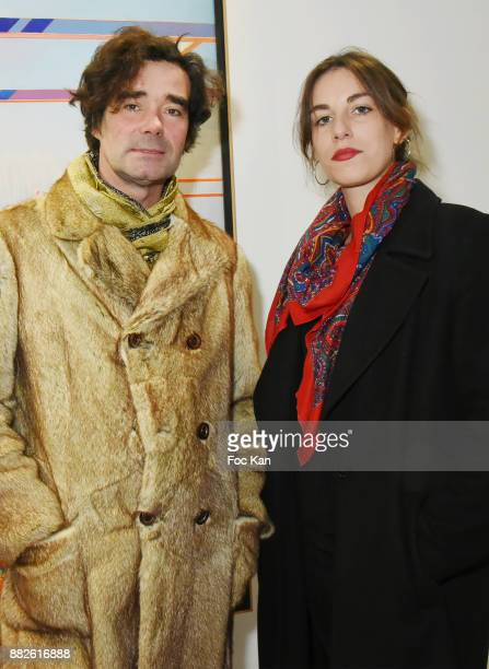 Artist Olivier Urman and Barbara Lagie attend the Tribute to Leonardo Cremonini Exibition Preview at Galerie T Lon November 29 2017 in Paris France