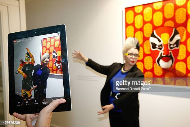 Artist Orlan standing between her works attends the FIAC 2014 International Contemporary Art Fair Official Opening at Le Grand Palais on October 22...