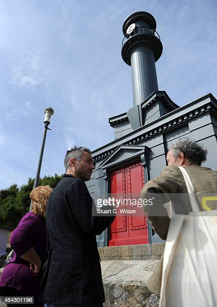 Artist Pablo Bronstein talks to journalists in front of his art installation displayed as part of the Folkestone Triennial Public Art Project on...