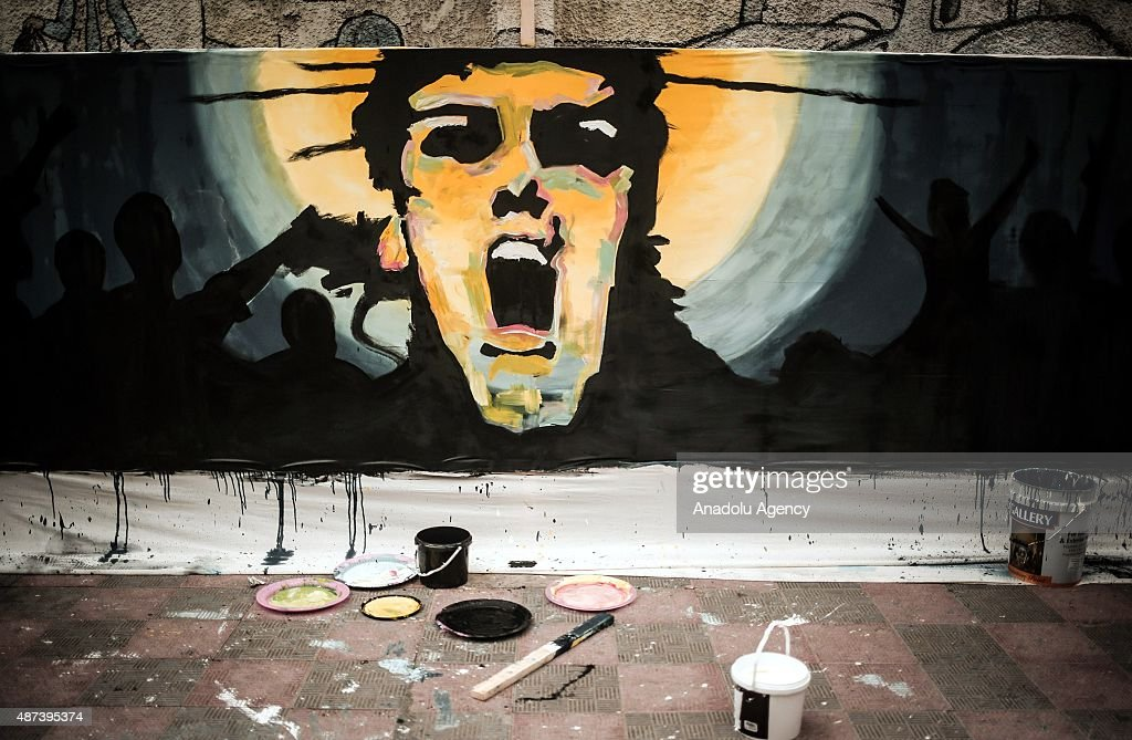 Artist paint murals on 50 meters long canvas under the sponsorship of UNESCO in Gaza City, Gaza on September 9, 2015.