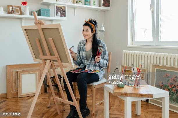 artist painting a picture on canvas - sexy drawing stock pictures, royalty-free photos & images
