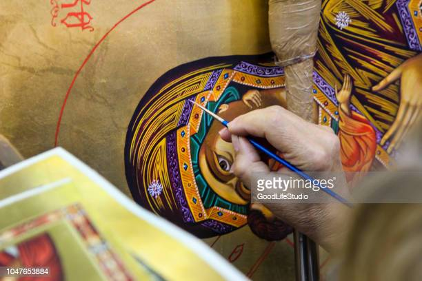artist painting a virgin mary icon - orthodox church stock pictures, royalty-free photos & images
