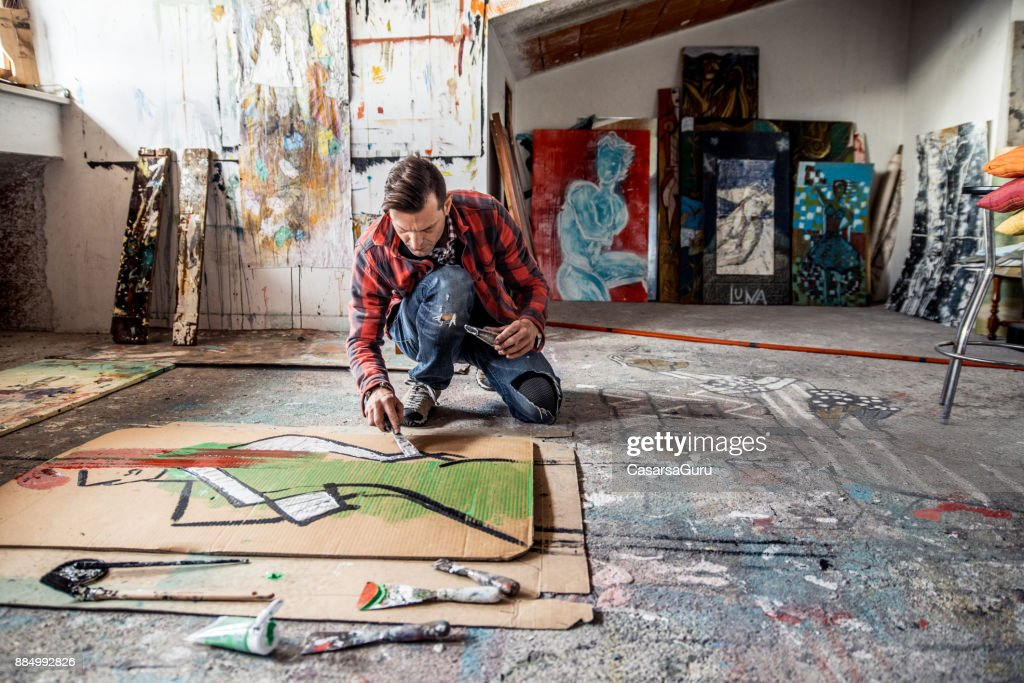 Künstler malen Leinwand Karton auf Boden : Stock-Foto