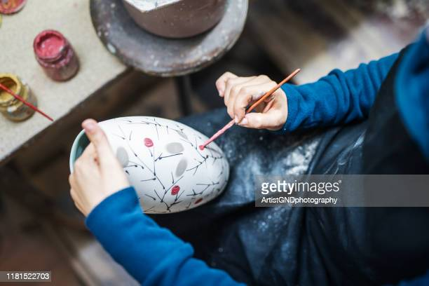 artist painting ceramica - ceramics stock pictures, royalty-free photos & images