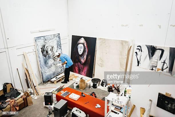 Artist painting in atlier