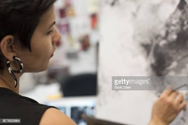 Artist painting in her studio
