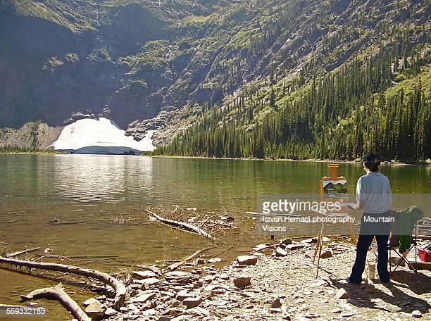 Artist painting mountain scenery