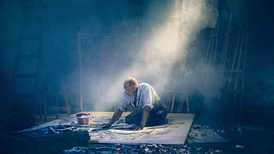 Artist painting picture in workshop rear view - gettyimageskorea