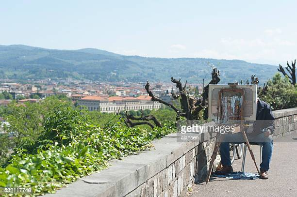 artist painting the city of florence