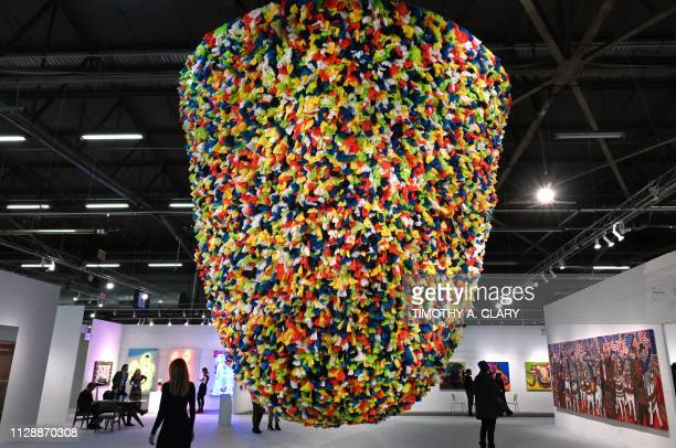 """Artist Pascale Marthine Tayou's """"Plastic Bags"""" is on display at the The Armory Show in New York March 6 staged on Manhattans Piers 90 and 94. - The..."""