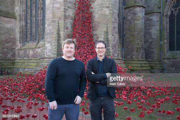 Artist Paul Cummins and designer Tom Piper poses for a photograph with the Weeping Window artwork which opens at Hereford Cathedral as part of the...