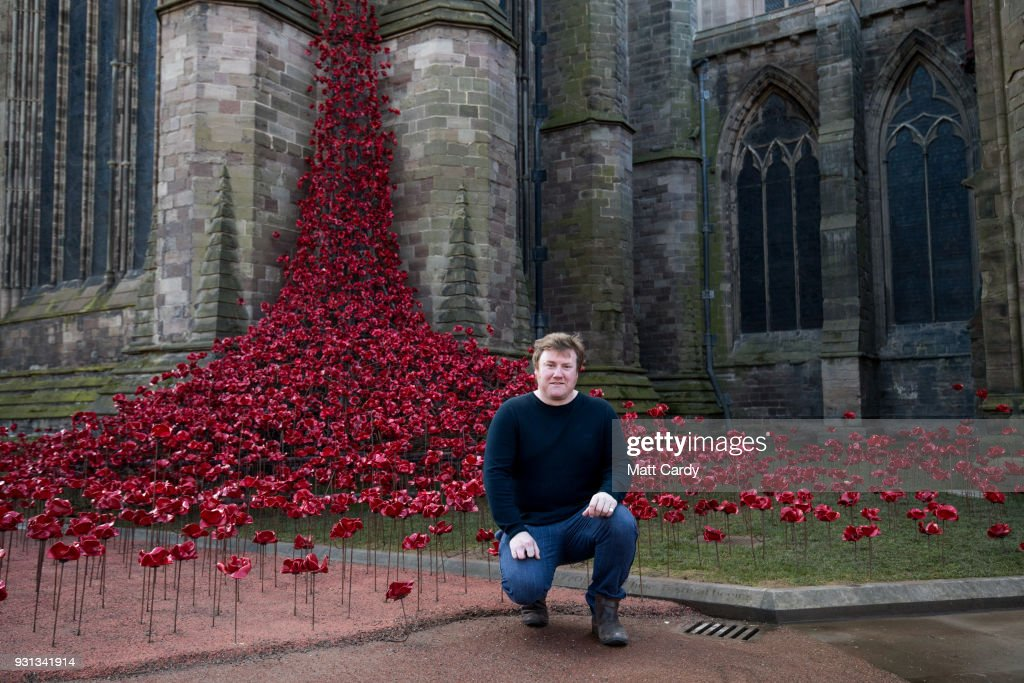 Artist Paul Cummins poses for a photograph with the Weeping Window artwork which opens at Hereford Cathedral as part of the final year of the 14-18 NOWs UK-wide tour of the poppies on March 13, 2018 in Hereford, England. The display of handmade poppies, called The Weeping Window, was put in place by a team under instruction of designer Tom Piper and artist Paul Cummins, first went on display at the Tower of London in 2014 and has since been on a tour of the country.