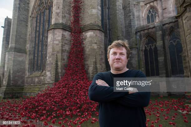 Artist Paul Cummins poses for a photograph with the Weeping Window artwork which opens at Hereford Cathedral as part of the final year of the 1418...