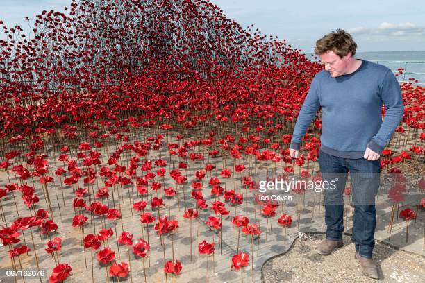 """Artist Paul Cummins views his poppy sculpture """"Wave"""" at Barge Pier, Shoeburyness, Southend-on- Sea as part of a UK-wide tour organised by 14-18 NOW..."""