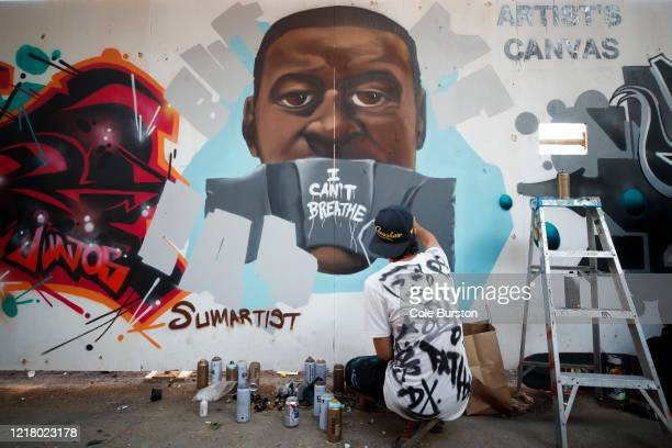 Artist Paul GlynWilliams puts the finishing touches on a George Floyd mural on June 6 2020 in Toronto Canada This is the 12th day of protests since...