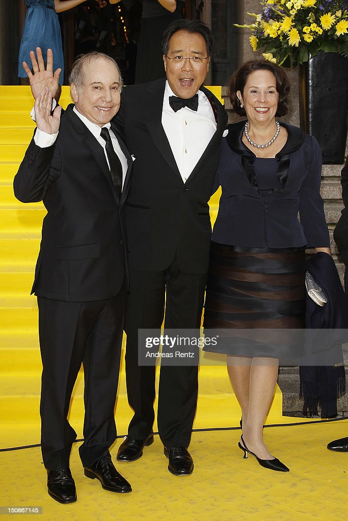 Artist Paul Simon, cellist Yo-Yo Ma and his wife arrive for the Polar Music Prize at Konserthuset on August 28, 2012 in Stockholm, Sweden.