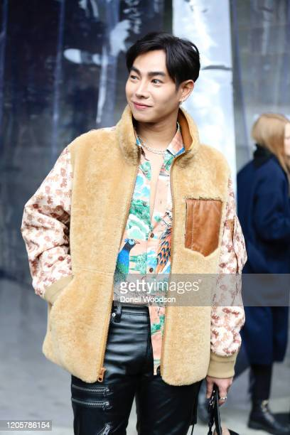 Artist Peck Palit is seen wearing a tan and brown coat black pants and colorful shirt outside of the Coach 1941 show during New York Fashion Week on...