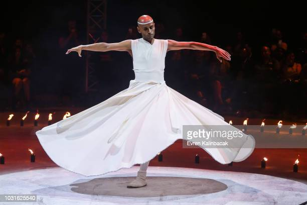 Artist performs on the runway at the Urun show during the MercedesBenz Istanbul Fashion Week on September 11 2018 in Istanbul Turkey