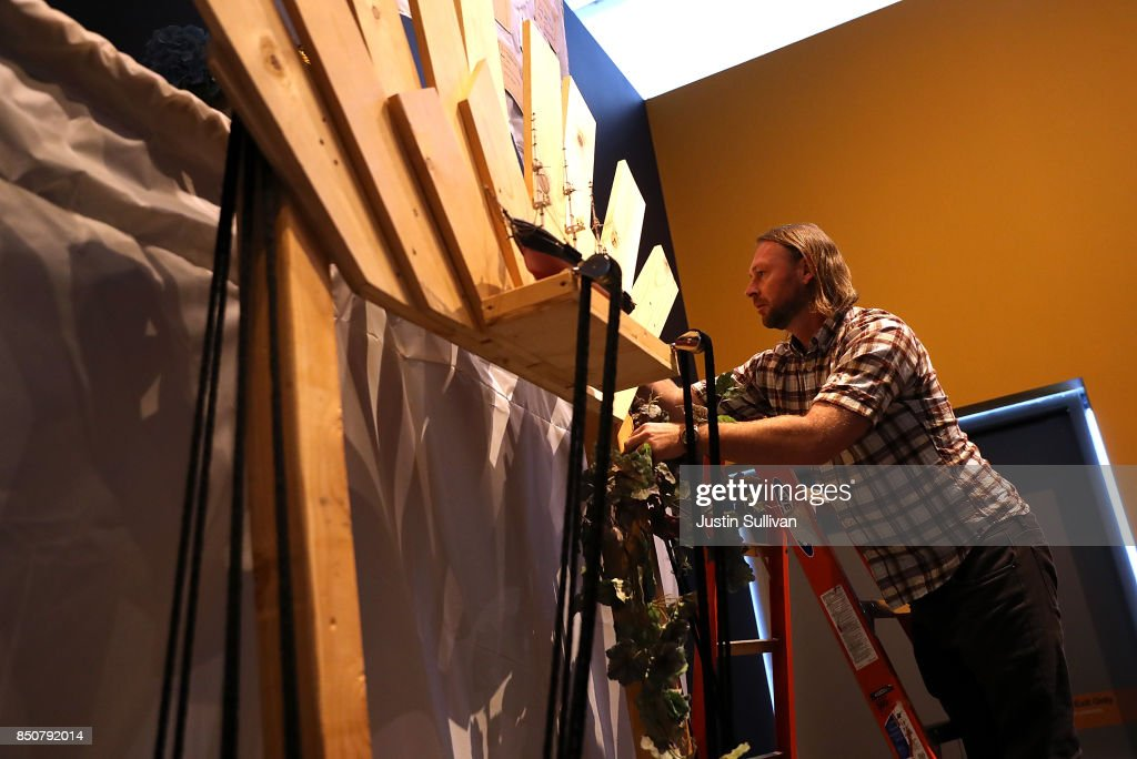 Artist Peter Foucaulton works on his 'Ghost Ship' art installation at the Oakland Museum of California on September 21, 2017 in Oakland, California. Local artists Chris Treggiari and Peter Foucaulton are building a memorial to honor their colleague Alex Ghassan and the dozens of people who died in the 2016 'Ghost Ship' warehouse fire. The installation will be part of the Oakland Museum of California's 23rd annual Dias de Los Muertos (Days of the Dead) Exhibition that runs from October 18, 2017 through January 14, 2018.