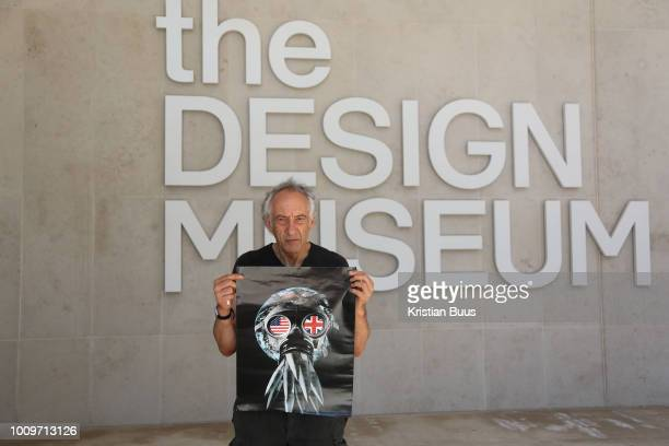 Artist Peter Kennard with a poster copy of his work which was on show at the Design Museum, London, Unted Kingdom, August 02 2018. He decided to pull...