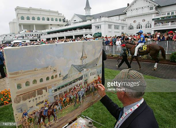 Artist Peter Williams paints a picture during morning workouts for the 133rd Kentucky Derby on May 4 2007 at Churchill Downs in Louisville Kentucky