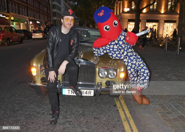 Artist Philip Colbert arrives with a cigarette smoking lobster at a private view of 'Philip Colbert New Paintings' at The Saatchi Gallery on October...