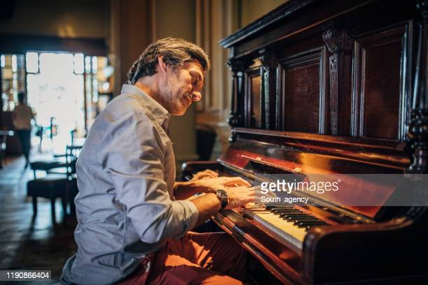 artist playing the piano - pianist stock pictures, royalty-free photos & images