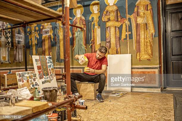 artist preparing tools to paint fresco in the church - religious symbol stock pictures, royalty-free photos & images