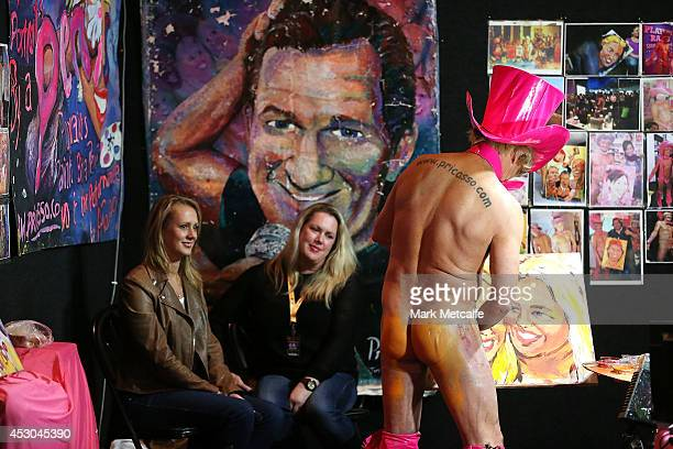 Artist Pricassso paints a portrait using his penis at the Sexpo 2014 Launch at Hordern Pavilion on August 1 2014 in Sydney Australia