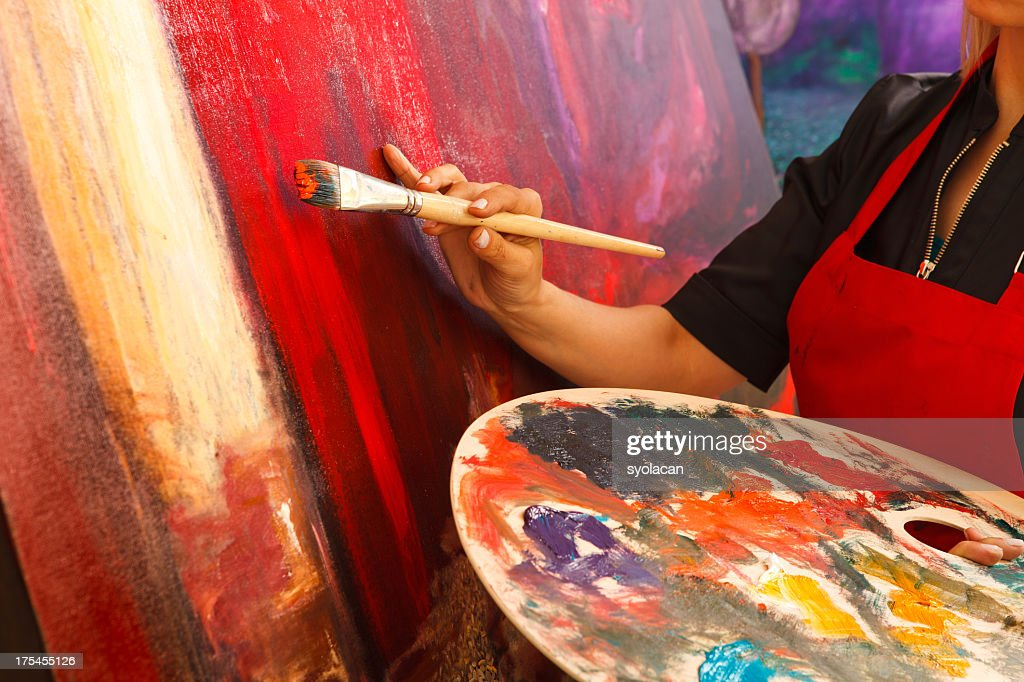 Artist putting the final magic touch on painting : Stock Photo