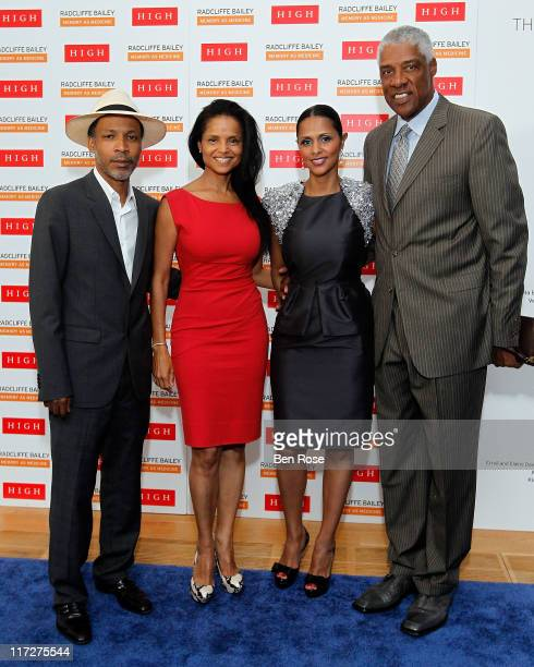 Artist Radcliffe Bailey and his wife actress Victoria Rowell pose with Dorys Erving and Julius Erving during a private reception for the opening of...