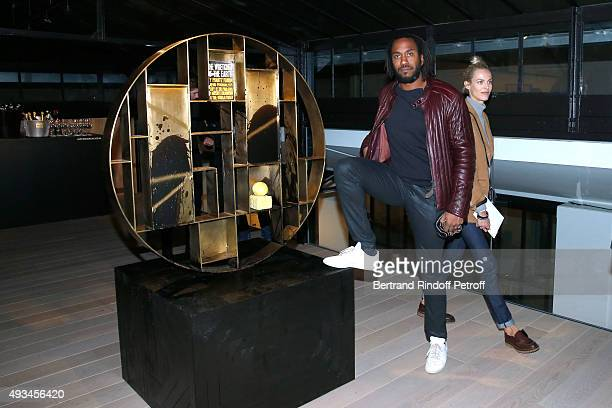 Artist Rashid Johnson poses in front of his work during the 'New American Art' Exhibition of Artists Matthew Day Jackson and Rashid Johnson Opening...