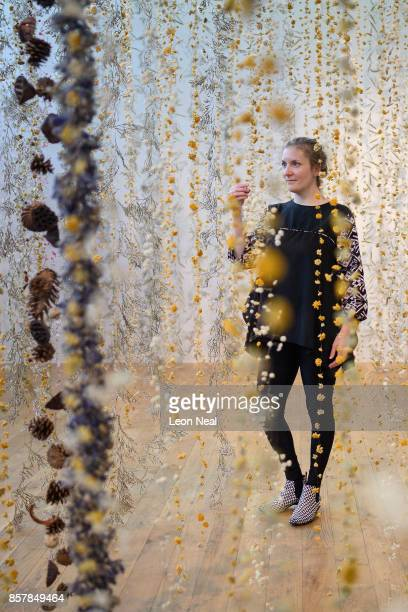 Artist Rebecca Louise Law poses with her new installation 'Life in Death' at Kew Gardens on October 5 2017 in London England The artwork comprising...