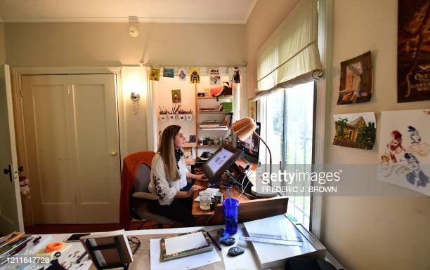 Artist Reem Ali Adeeb works in her studio apartment in Los Angeles, California on April 29 where she is developing online tutorials in Arabic for...