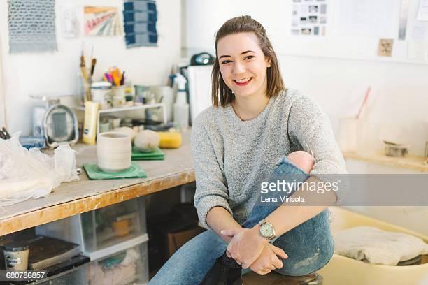 Artist relaxing in pottery studio