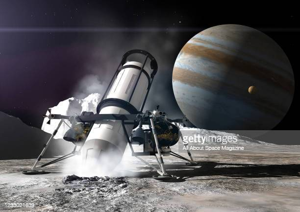 Artist rendering of a NASA drill probe on the icy surface of Europa, one of 79 Jovian moons, created on July 24, 2013. Jupiter and Io, another moon,...