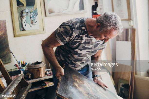 artist restoring an old painting - antique shop stock pictures, royalty-free photos & images