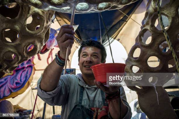 Artist Ricardo Linares paints an alebrijee Mexican folk art sculpture at his studio in Mexico City Mexico on Wednesday Oct 18 2017 Ricardo Linares...