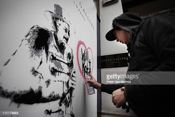 Artist Rich Simmons creates a painting celebrating the wedding of Prince William and Kate Middleton outside The Opera Gallery on March 16, 2011 in...