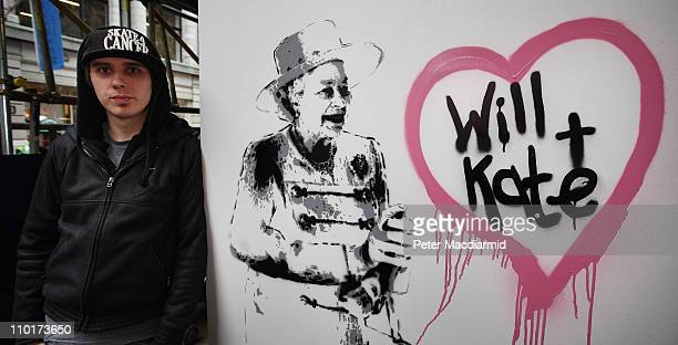 Artist Rich Simmons stands next to his painting celebrating the wedding of Prince William and Kate Middleton outside The Opera Gallery on March 16,...