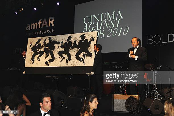 Artist Richard Hambleton paiting is auctioned at amfAR's Cinema Against AIDS 2010 benefit gala dinner at the Hotel du Cap on May 20, 2010 in Antibes,...