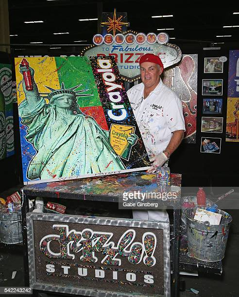 Artist Robert Holton displays a painting he did for Crayola in the Drizzle Studios booth at the Licensing Expo 2016 at the Mandalay Bay Convention...