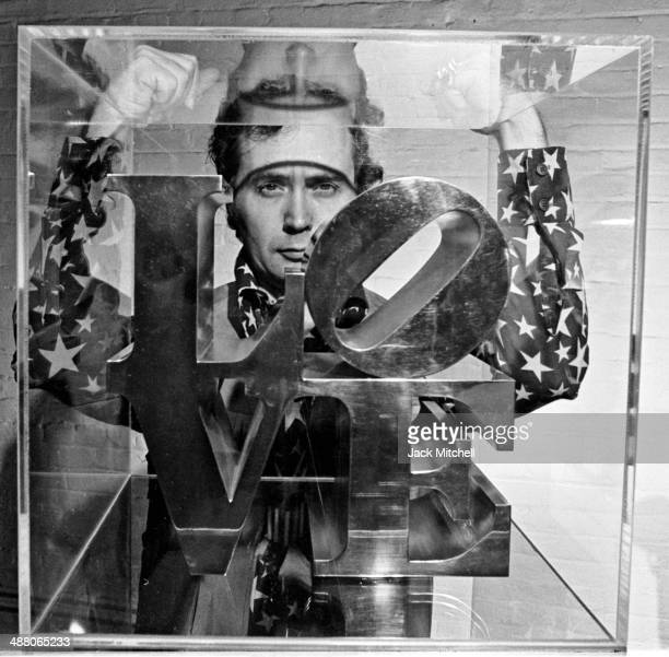Artist Robert Indiana photographed in his NYC studio with his 'LOVE' sculpture January 1969