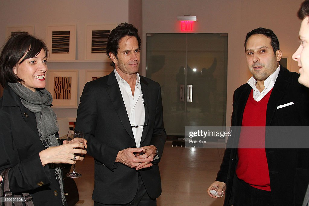 Artist Robert Kelly (2nd L) and Farhad Farman Farmaian (R) attend An Intimate Evening With The Contemporary Patrons Of The Watermill Center at 210 East 5 Street on January 15, 2013 in New York City.