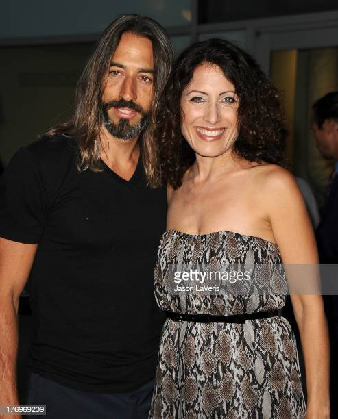 Artist Robert Russell and actress Lisa Edelstein attend the premiere of 'Afternoon Delight' at ArcLight Hollywood on August 19 2013 in Hollywood...