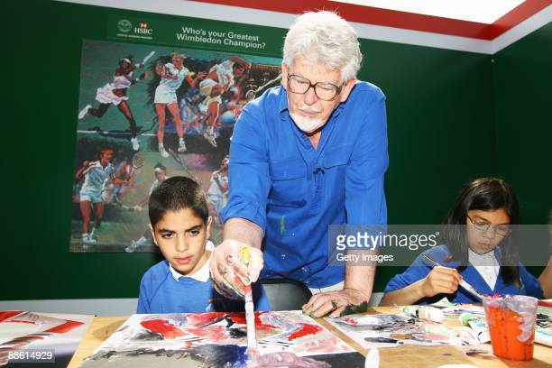 Artist Rolf Harris assists children with picture painting on Day One of the Wimbledon Lawn Tennis Championships at the All England Lawn Tennis and...