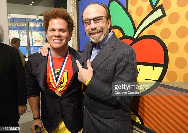 Artist Romero Britto and Bernie Yuman attend Britto Central Gallery's 20th Anniversary Celebration on December 11 2013 in Miami Florida