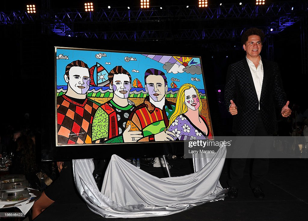 Artist Romero Britto poses onstage at the Zenith Watches Best Buddies Miami Gala at Marlins Park on November 16, 2012 in Miami, Florida.