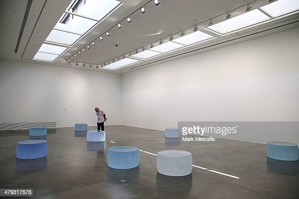 Artist Roni Horn's glass castings 'Ten Liquid Incidents' are displayed during a media preview as part of the 19th Beinnale of Sydney at the Museum of...