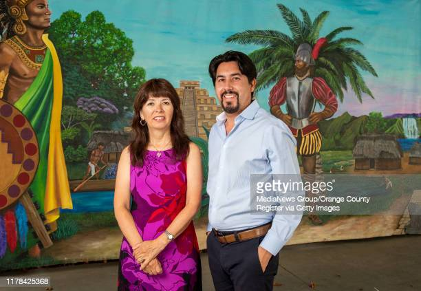 Artist Rosemary Vasquez Tuthill left and Kevin Cabrera executive director of the Heritage Museum of Orange County are shown next to the restored...